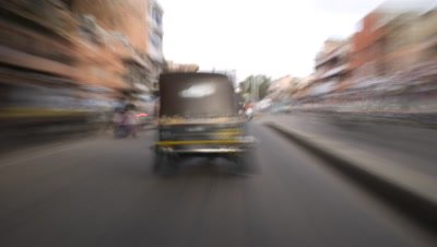 Medium wide angle frenetic, forward facing view of road from car mounted camera as travelling through busy traffic