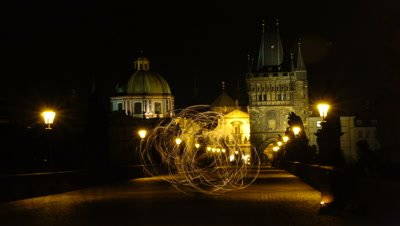Medium wide angle from middle of Charles Bridge looking across to Old Town featuring fire jugglers
