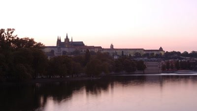 Wide angle view from river to Prague Castle, Hradcany, as dusk becomes evening with Charles Bridge