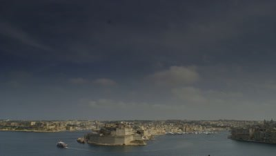Wide angle blue sky view across Valetta harbour showing entrance to both Grand and Marsamxett harbours