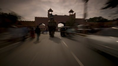 Medium wide angle point of view of tuk-tuk driver moving through busy traffic in Jaipur