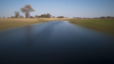 Mid shot point of view riding on a speeding bullet as races through waterways of the Okavango Delta