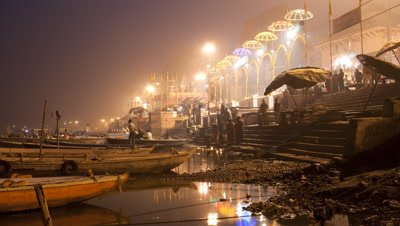 Wide angle Hindus performing Ganga Aarti flame ritual on banks of Ganges at Varanasi