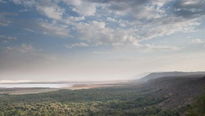 Big wide angle looking along escarpment of Great Rift Valley towards Lake Manyara as afternoon daylight fades to darkness