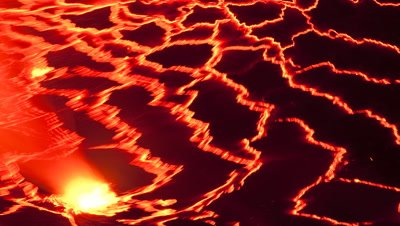 Close up pulsing red hot molten lava in Nyiragongo Volcano's lava lake