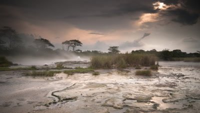 Wide angle steam rising from bubbling hot springs in the Ruwenzori mountains