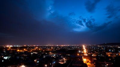 Wide angle city of Jaipur skyline at night under stormy sky