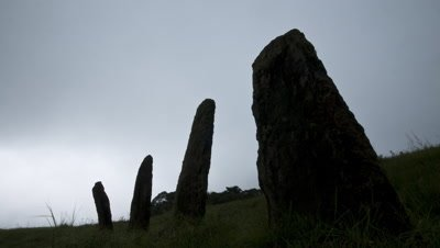 Mid shot ancient standing stones silhouetted and shrouded in mist in Khasi Hills Meghalaya