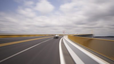 Medium wide angle POV bonnet mounted camera in Manaus traffic on open highway, over Amazon bridge and in built up city