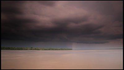 Blackening clouds build to rain over the Rio Negro, Amazon, Brazil