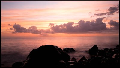 Sunset over the Caribbean with rocky foreshore, Champaigne Beach