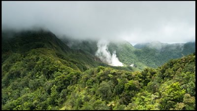 Low cloud over forest and bloiling lake in Morne Trois Pitons national Park, Dominica
