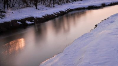 Orange sunrise over winter forest and river from Otowa Bridge, Tsurui, Hokkaido, Japan