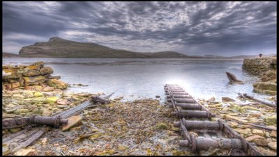 Grey clouds brew over whaling staion and ramp on New Island, Falklands