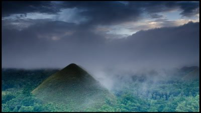 Clouds and mist drift across Chocolate Hills in Bohol Province, Philippines