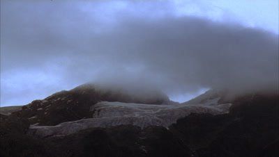 Medium wide angle clouds clear to reveal Elena Glacier atop Mt Stanley