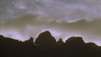 Mid shot granite peaks of Mt Stanley as evening falls with dusting of snow against snow threatening sky