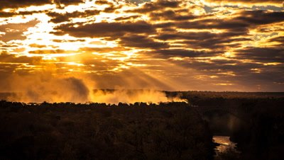 Sunrise through spray and clouds, Victoria Falls Bridge