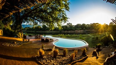 Sunrise over looking pool, Chongwe house