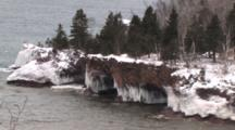 Peninsula With Ice Formation, Cliffs, Caves In Lake Superior Winter Scene