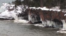Ice Draped Cliffs And Caves, Large Breaking Waves, Peninsula On Lake Superior North Shore