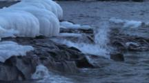 Waves Breaking Across Ice Capped Shelf On Lake Superior North Shore