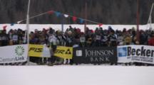 American Birkebeiner, Pan Across Crowd Of Skiers Waiting For Starting Banner To Lift