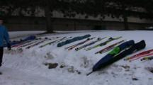 American Birkebeiner, Skis Laying In Snow, Waiting For Start Of Race, Skiers Passing  By