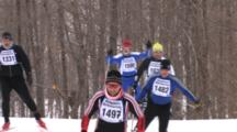 American Birkebeiner, Skiers Coming Up Over Hill, Spectators Crossing Trail