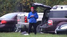 Pre-Race Preparation, Runner Preparing, Sorting Through Equipment In Back Of Vehicle