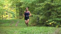 Runner Coming Up Hill On Wooded Trail, Winning Racer