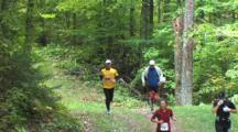 Foot Race On Wooded Trail, Runners Exit