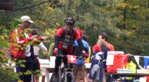 Bicyclist Working At Foot Race, Support Staff