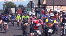 Chequamegon Mountain Bike Race, Large Group Of Bicyclists Beginning Race, Bystanders On Side Of Road