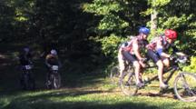 Chequamegon Mountain Bike Race, Racers Coming Into Sunlight From Wooded Copse