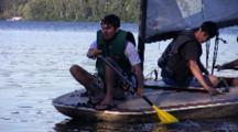 Boys Rowing Sailboat To Shore