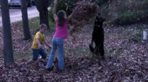 Children And Dogs Playing In Leaves, Dog Jumps Up, Dog Getting Tired