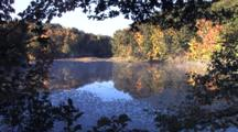Autumn Lake Scene, Mist, Surrounded By Deciduous Leaves