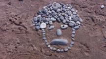 Caricature Of Man On Beach, Made From Stones