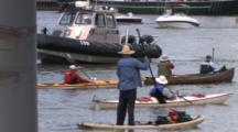 Canoes, Kayaks, Police Boats, Man Standing, Paddling In Lake Michigan Harbor