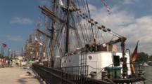 Tall Masted Sailing Ships Anchored In Harbor, Pan Up, Zoom To Masts, Rigging