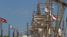 Masts And Rigging Of Tall Masted Sailing Ships Anchored In Harbor