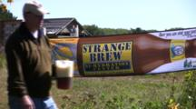Beer Banner, Strange Brew, Chequamegon Fat Tire Bike Race, Man Walks By With Pitcher Of Beer