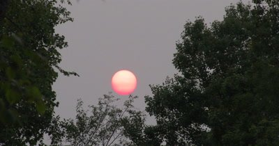 Red,Setting Sun,Haze in Atmosphere from Distant Forest Fires