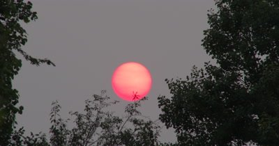 Time Lapse Red,Setting Sun,Sun Spots Visible,Haze in Atmosphere from Distant Forest Fires