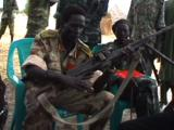 Spla Officer Talking And Handling Gun. Southern Sudan