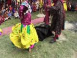 Dancer In Black Mask Lies Prone. Ceremonial Dance. Tibet