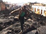 People Walking On Top Of Lava Main Street Of Town. Goma, Drc, 2002