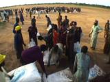 People Collecting Wfp Aid Sacks, One Woman Forcibly Excluded. Sudan