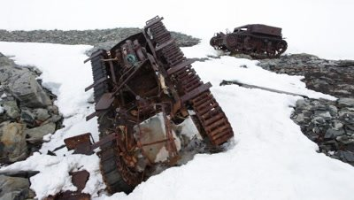 2 Derelict 'tanks' used by Americans to carry supplies at Stonington American army base, Antarctic Peninsula, Antarctica